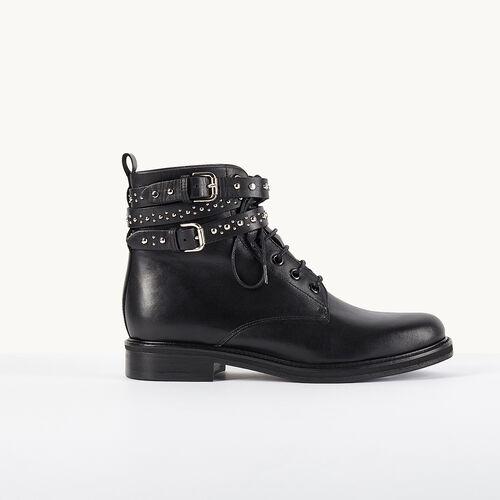 Botín de piel con tiras tachonadas - Zapatos - MAJE