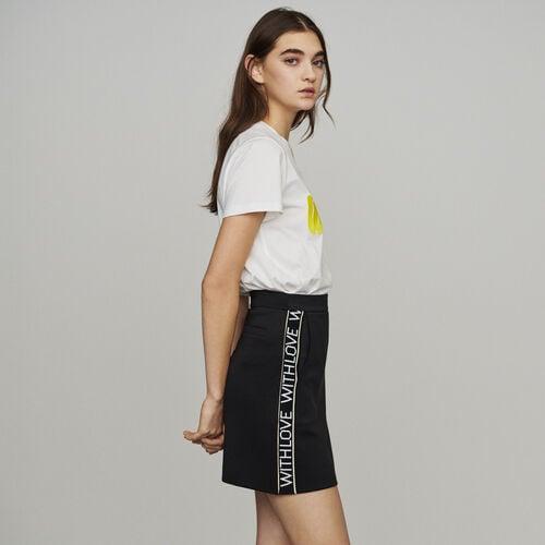 Falda corta y bandas con mensaje : New in : Colección Verano color Negro