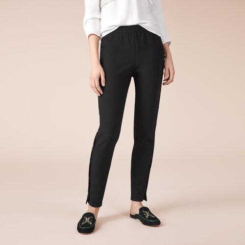 Pantalón de crepé con automáticos : Pantalones color Negro