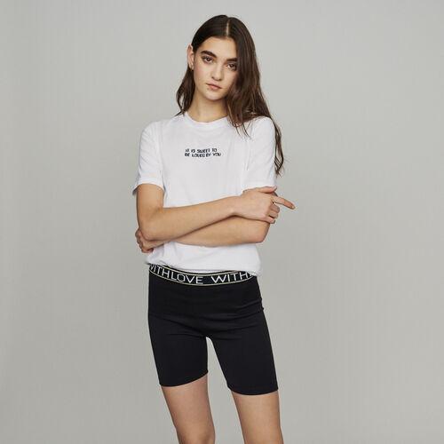 Short tipo boxer con textos : Faldas y shorts color Negro