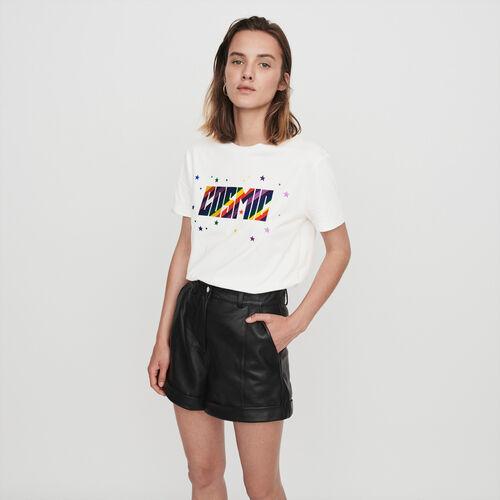 Short de cuero con vueltas y pespuntes : Faldas y shorts color Negro