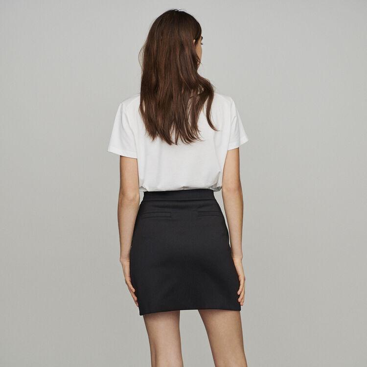 Falda corta y bandas con mensaje : Faldas y shorts color Negro