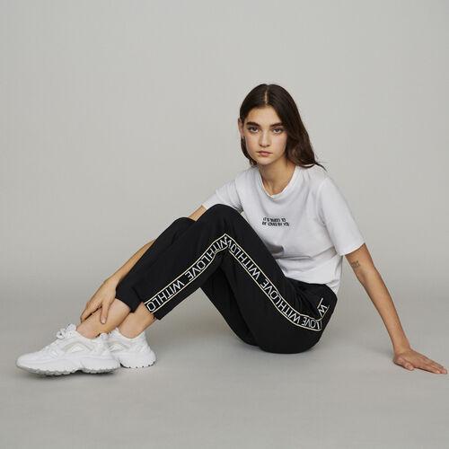 Pantalón elástico y bandas con mensaje : Pantalones color Negro