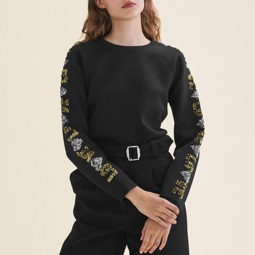 Sudadera tipo neopreno con lentejuelas : T-shirts color Negro