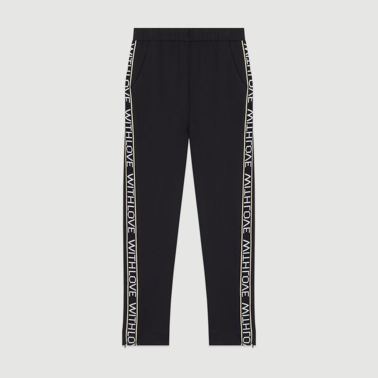 Pantalón elástico y bandas con mensaje : Pantalones y Jeans color Negro